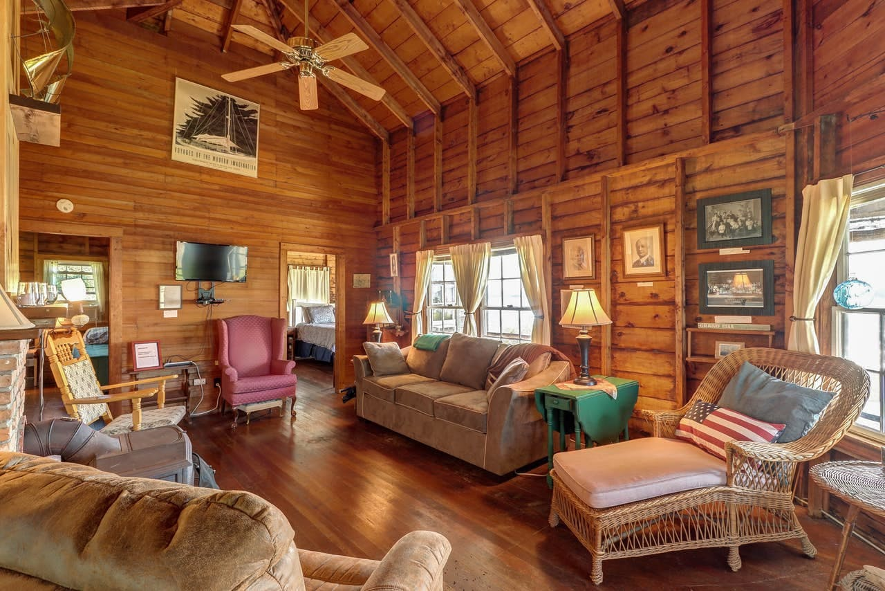 Cozy and rustic, the interior features exposed wood beams and vintage furnishings