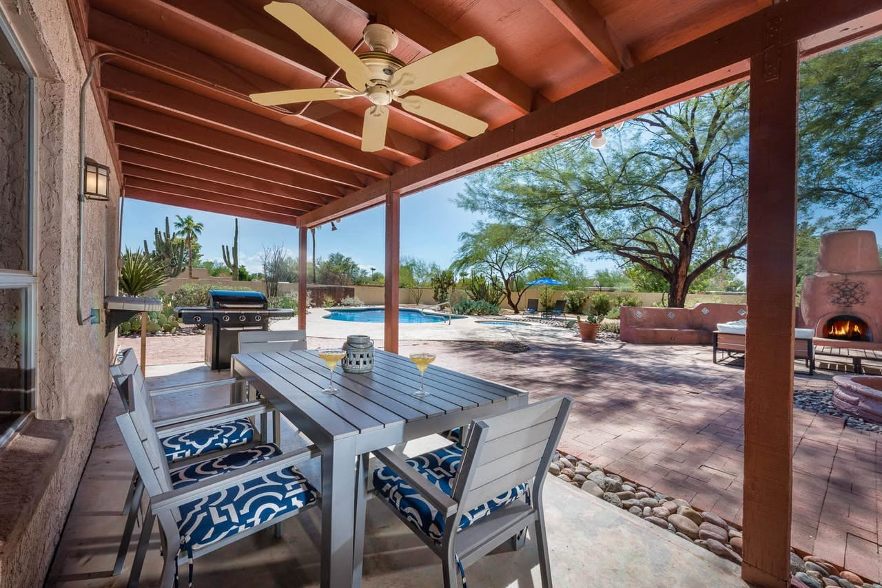 a large backyard in scottsadale that features a fireplace and private swimming pool