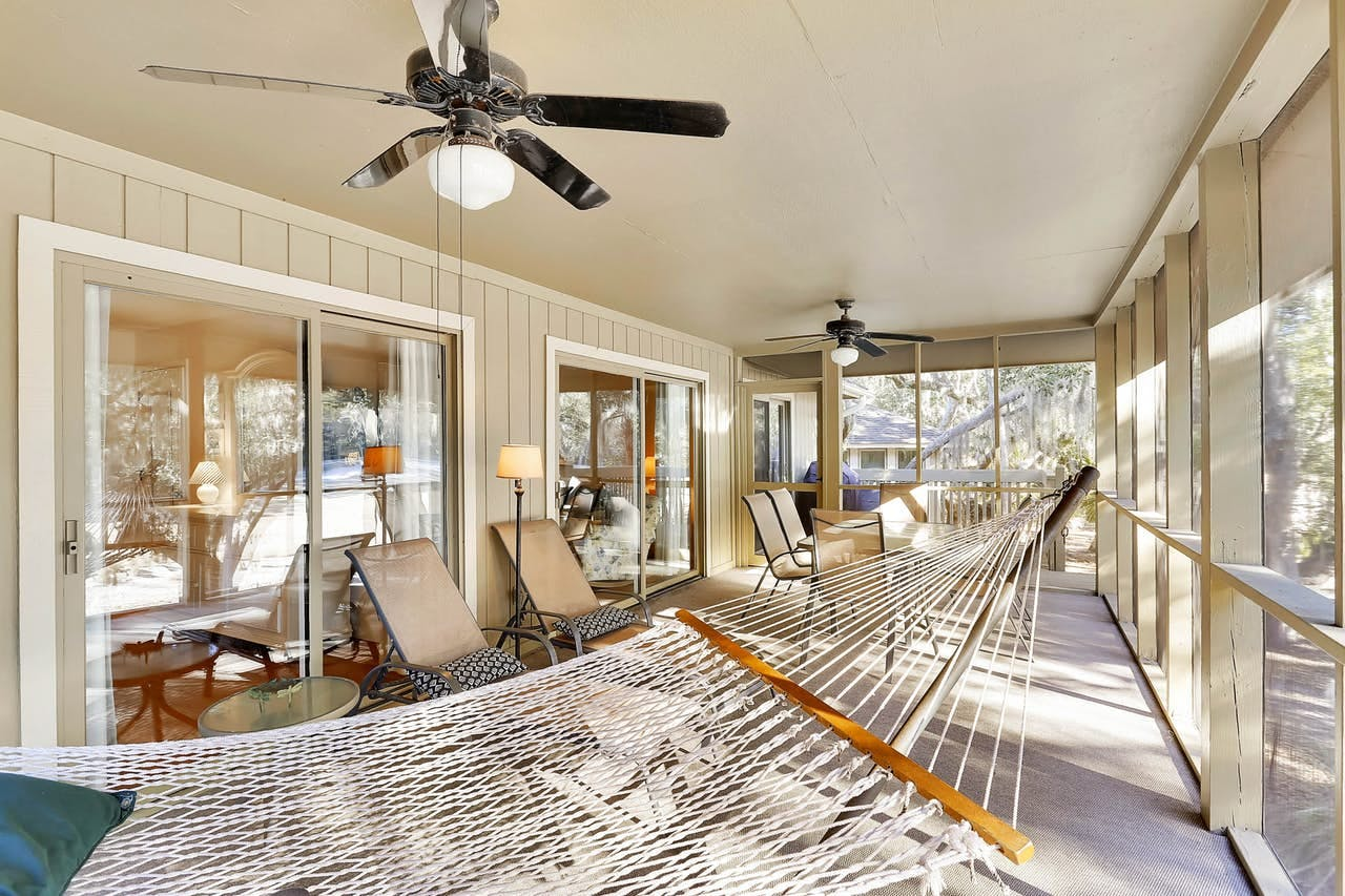 a hammock on the porch with a fan ovearhead at a home in seabrook island