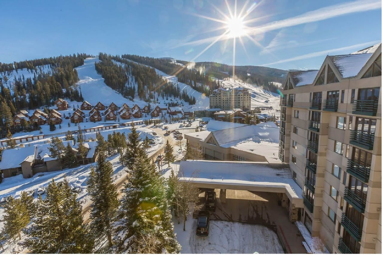 the exterior of an upscale resort in big sky that is close to the ski hills