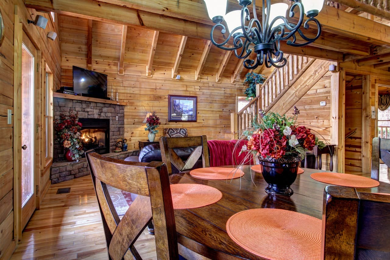 the dining room inside of a smoky mountain vacation cabin
