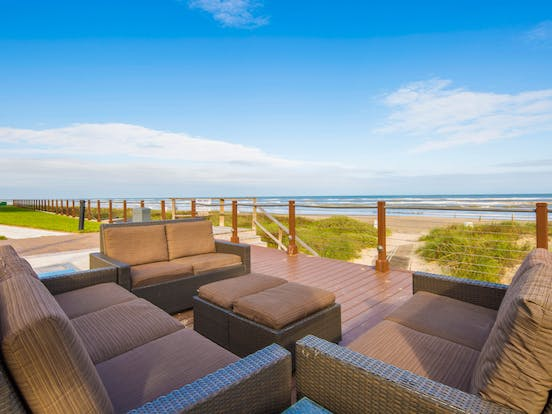 Lounge chairs overlooking the beach in South Padre