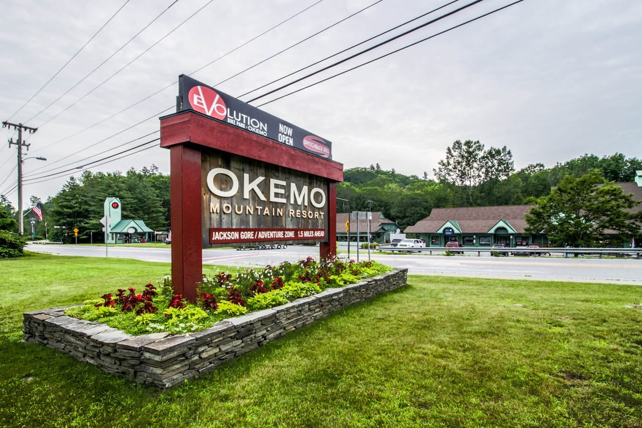 a road sign for okemo mountain resort