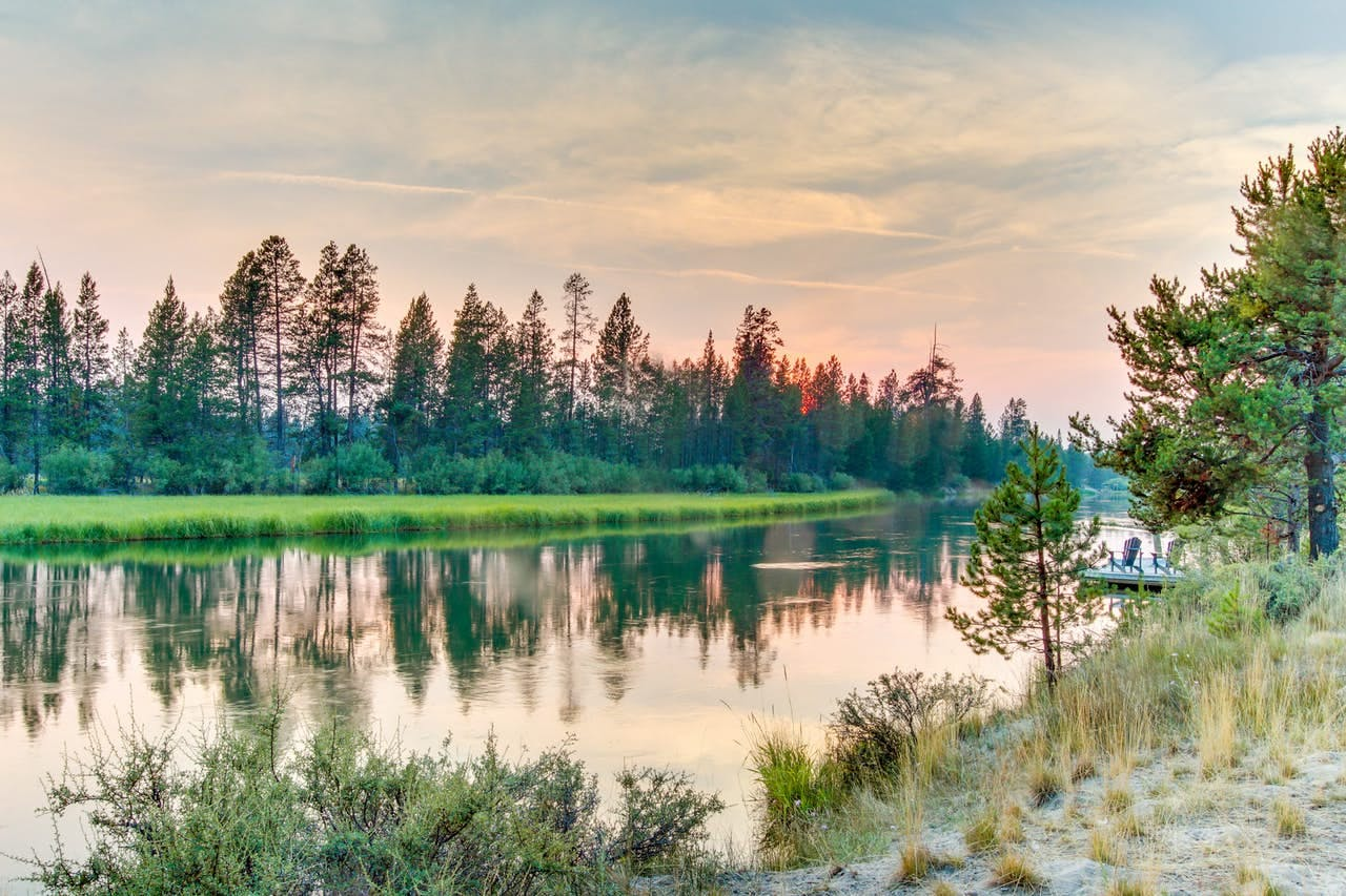 The deschutes river near sunriver with the sun setting in the background