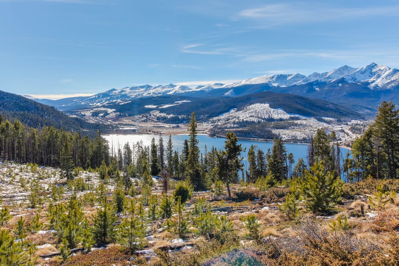a view of the lake as the snow begins to melt in Keystone, CO