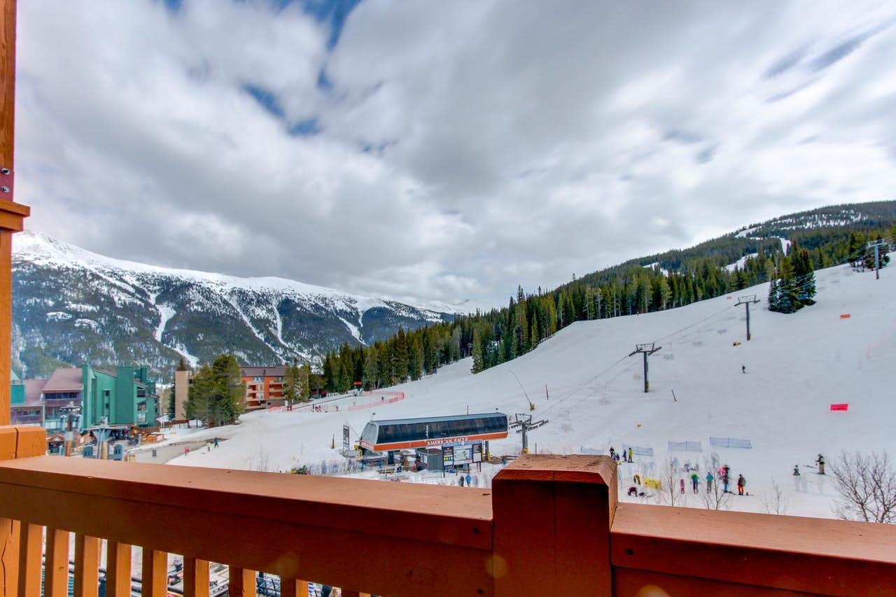 Copper Mountain lodge balcony with view of skiers getting on lift