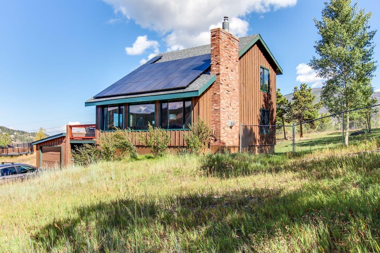 a small cabin located in Summit Cove, CO