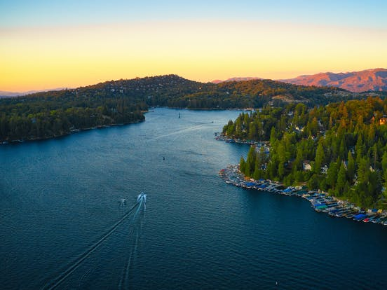 lake arrowhead in California with boats in the water at sunset