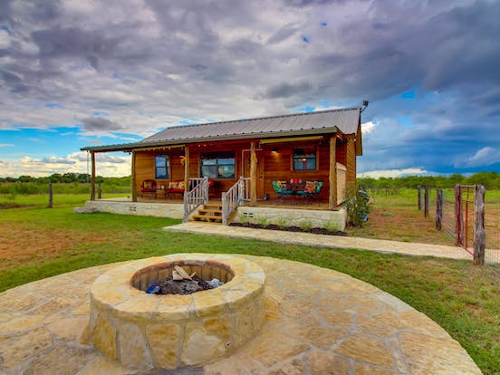 Cozy country cabin located in Fredericksburg, TX with expansive yard and firepit