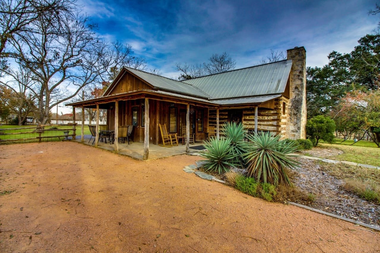 Exterior of cabin with ample front porch seating located in Fredericksburg, TX