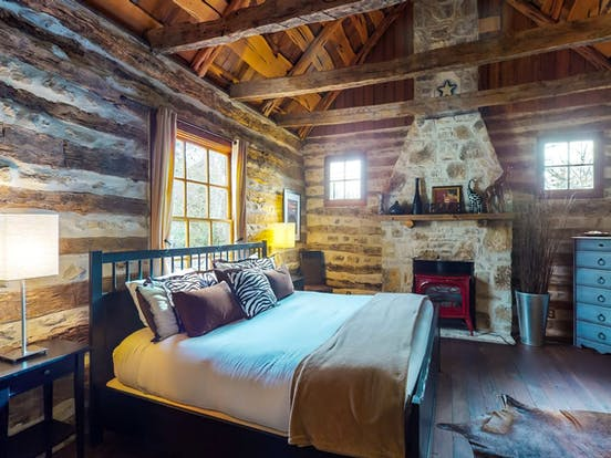 gas fireplace in the master bedroom of Fredericksburg, TX cabin