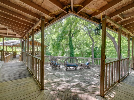 Spacious back porch with creek views