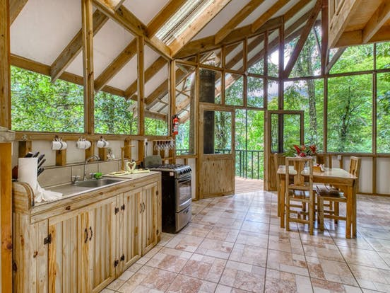 Treehouse vacation rental kitchen area surrounded by Costa Rican rainforest