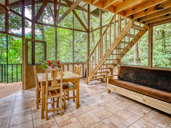 Treehouse vacation rental living area with views of surrounding Costa Rican rainforest