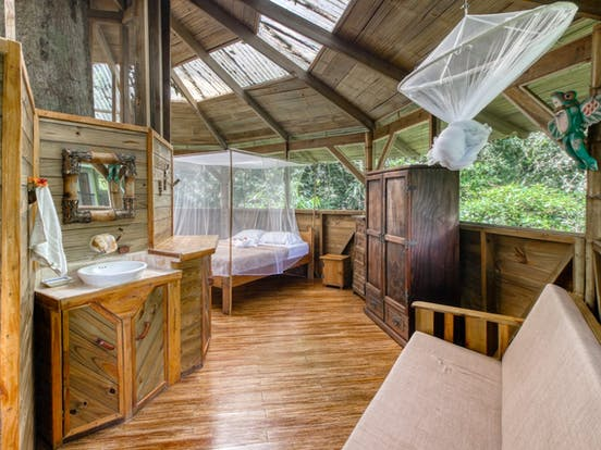 Bedroom and rest area of treehouse vacation rental in Costa Rica