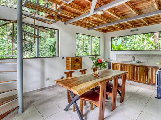 Kitchen and spiral staircase of treehouse vacation rental in Costa Rica