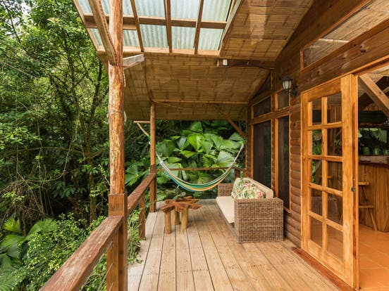 Treehouse vacation rental deck with hammock overlooking the rainforest