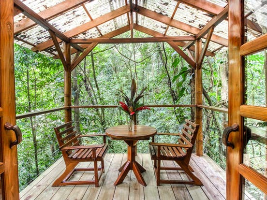 Treehouse vacation rental deck with dining area