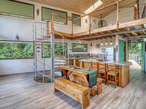 Interior and spiral staircase of a treehouse vacation rental in Costa Rica