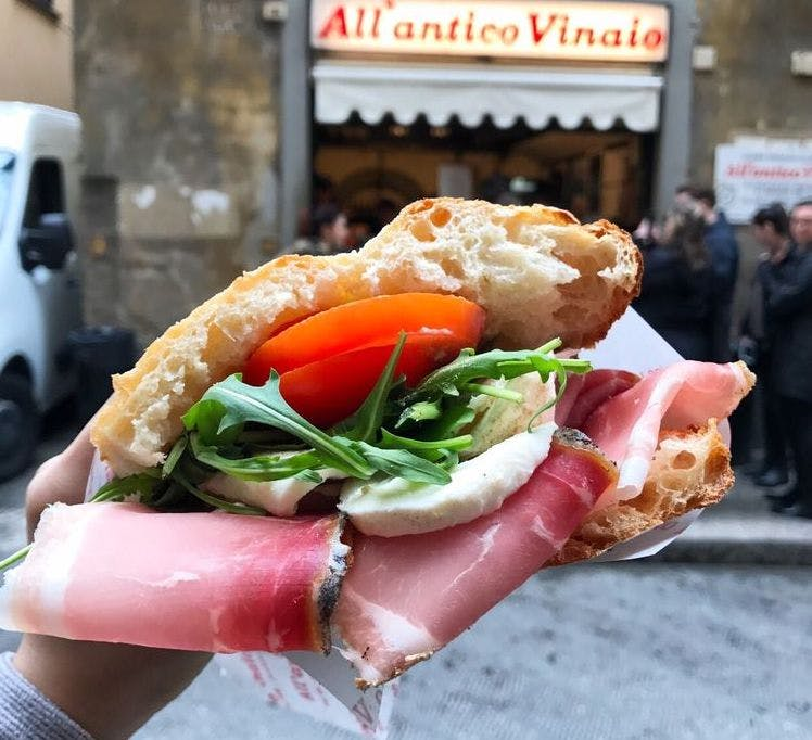 Enjoying a panino in front of All'antico Vinaio