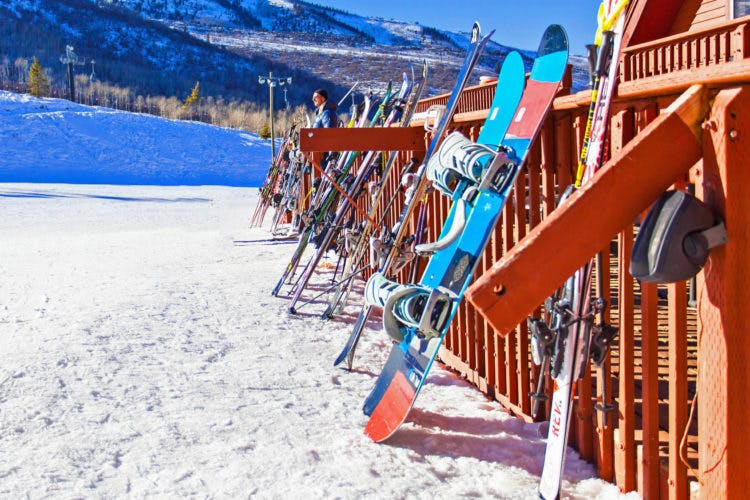 Snowboards lined up at the lodge in Park City