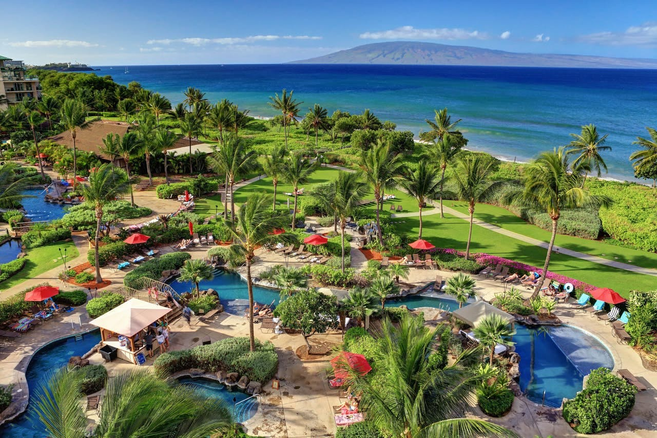 Hawaii's Honua Kai resort features towering palm trees and amazing outdoor pools