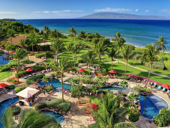 Hawaii's Honua Kai resort palm trees and outdoor pools
