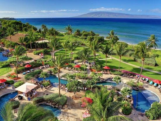 Hawaii's Honua Kai resort palm trees and outdoor pools