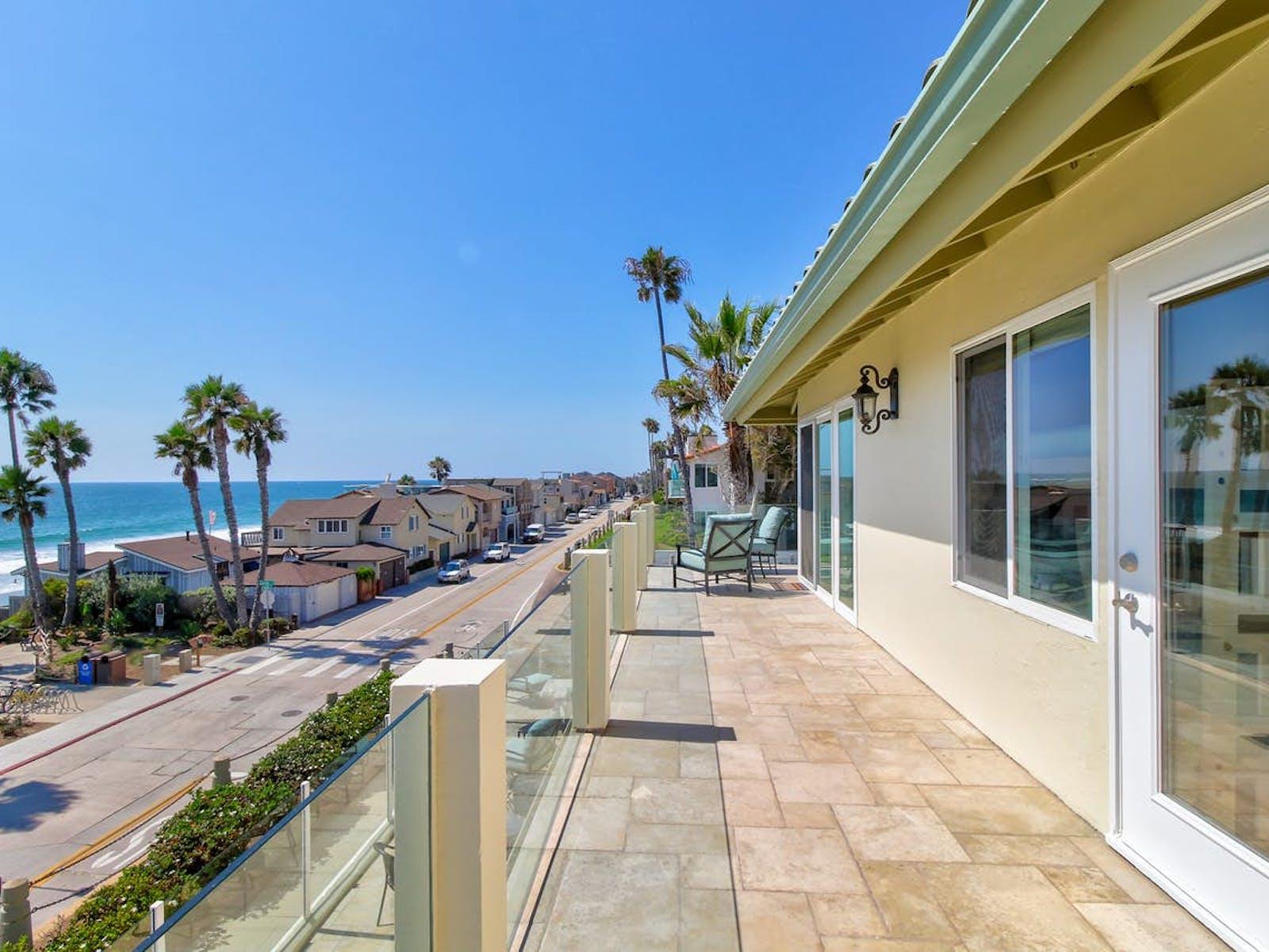 Blue skies and coastline of vacation rentals in Oceanside, CA