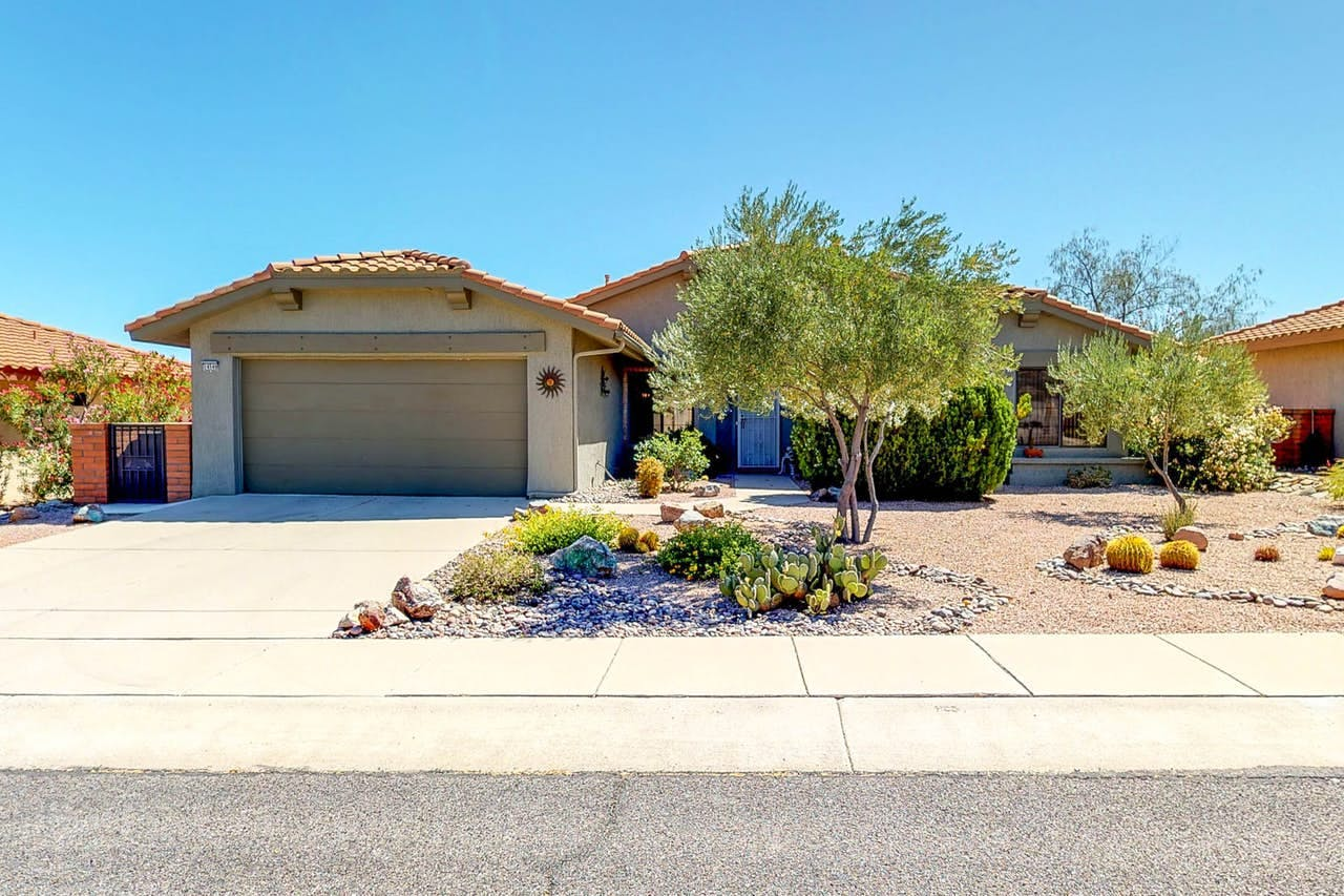 Vacation home with landscaping located in Oro Valley, AZ