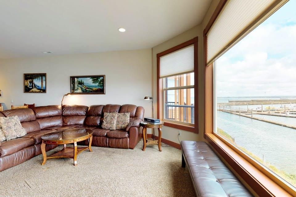 the living room of Captain's Quarters in Westport, WA, overlooking the water