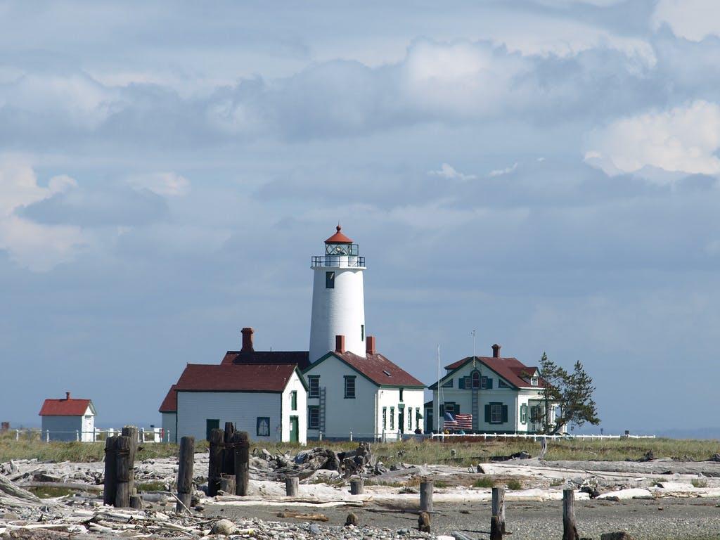 an old lighthouse on the shore of Sequim, WA