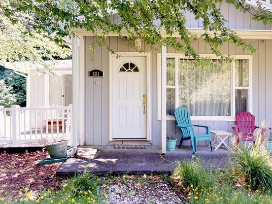 the front porch of a coastal cottage in westport, wa