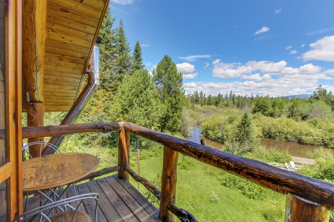 Gorgeous log cabin in McCall, ID with sprawling gardens, lawns, and a pond
