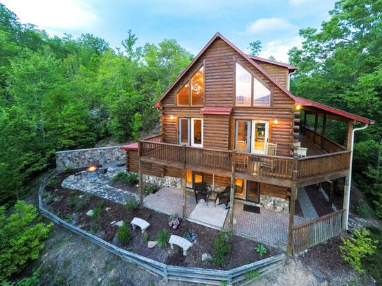 Large three-story cabin rental with wraparound deck in North Carolina