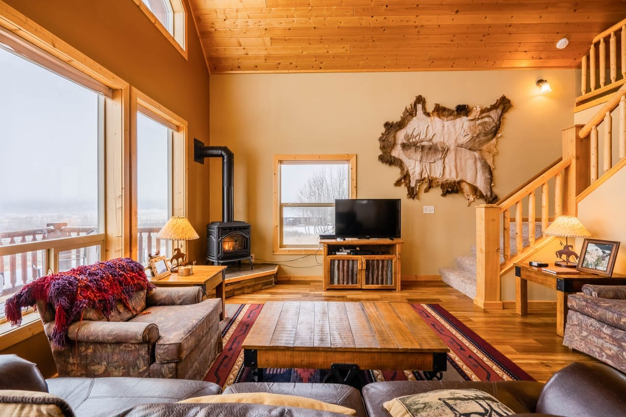 Island Park, ID vacation rental with wood burning stove, flatscreen tv and plenty of seating