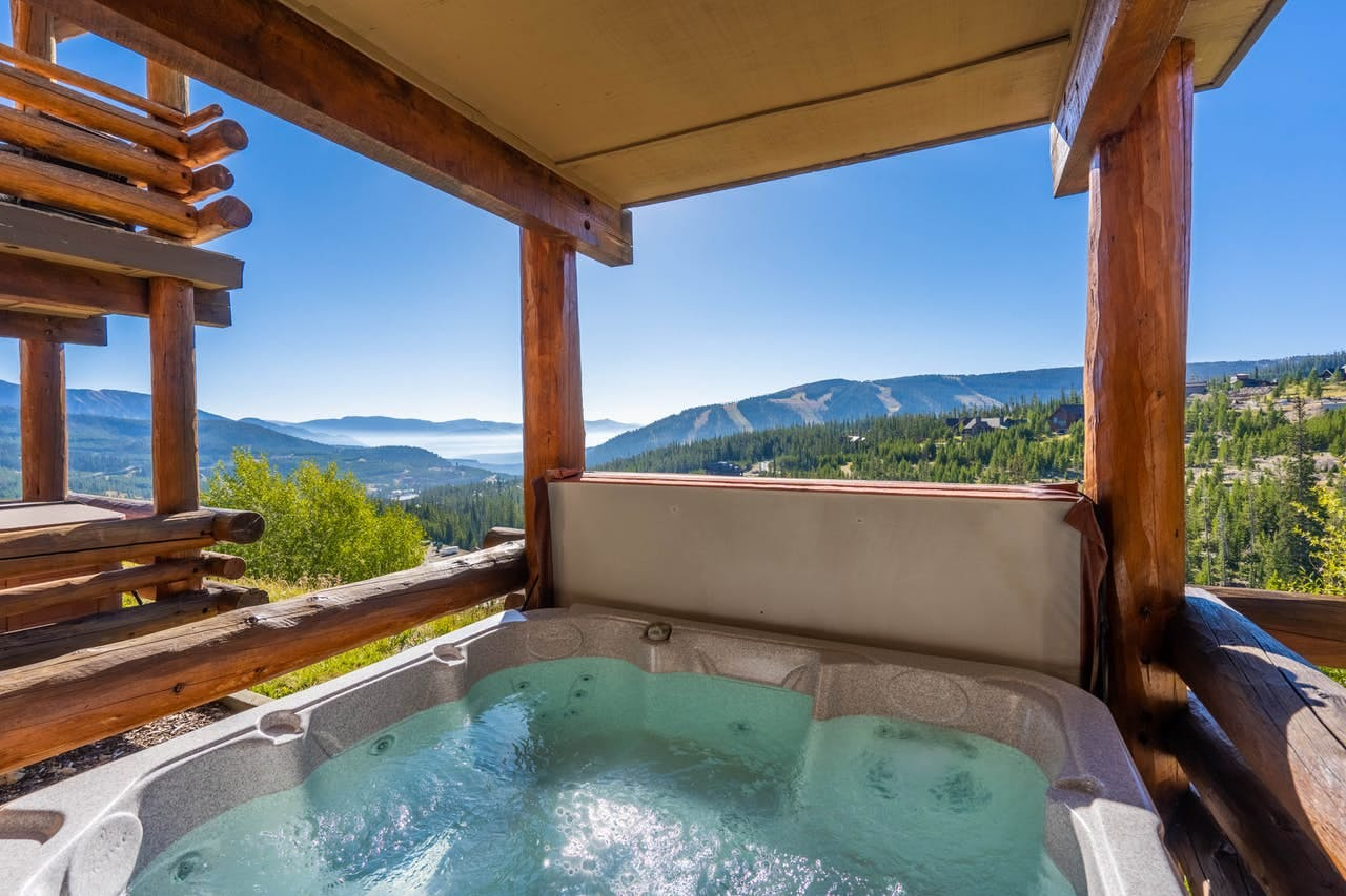 Private hot tub with breathtaking views of Big Sky Resort and surrounding mountains