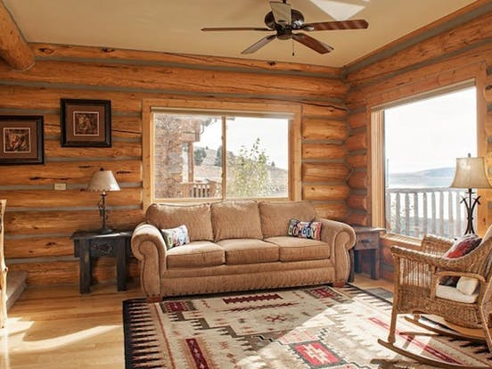 Living room of West Yellowstone rental with views of Hebgen Lake