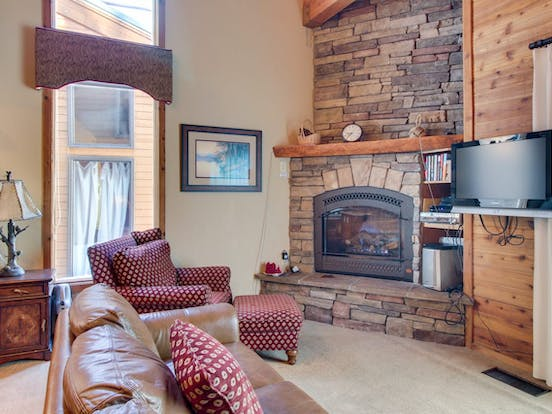 Mammoth Lakes vacation rental interior with fireplace and cozy furnishings